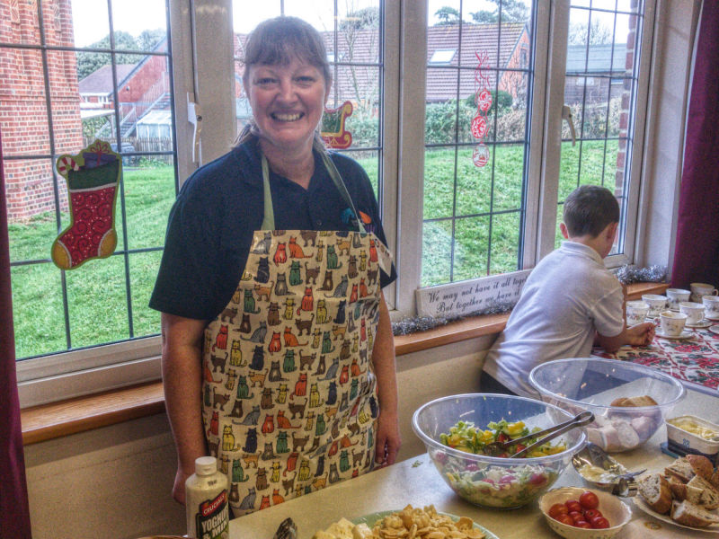 Inez serves food for the community at Meet and Eat